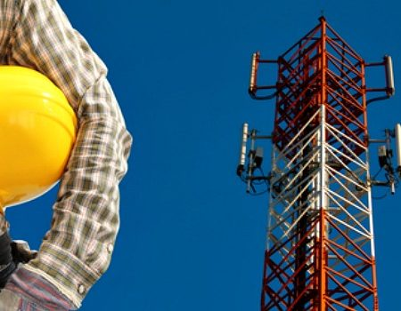 cell-tower-worker-next-to-cell-tower